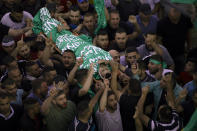 Palestinian mourners carry the body of Nidal Safadi, who was killed in clashes with Israeli forces, during his funeral in the West Bank village of Urif, near Nablus, Friday, May 14, 2021. (AP Photo/Majdi Mohammed)