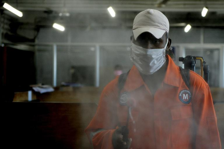 A health worker sprays disinfectant inside government offices in Chennai on June 13, 2020