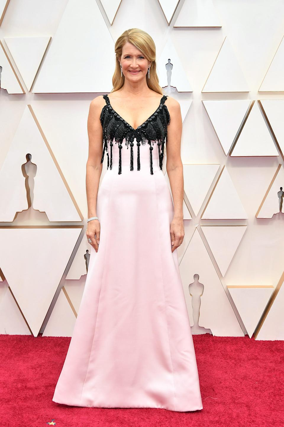 """The Oscar nominee arrived on the red carpet in a pink and black Armani gown. Dern is favoured to take home the award for Best Supporting Actress for her role as a cutthroat attorney in """"Marriage Story."""""""