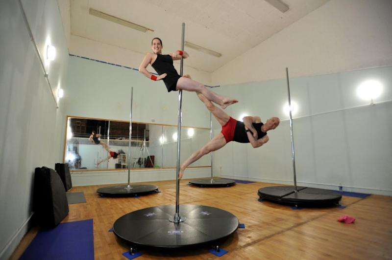 The pair started off pole dancing separately, but were soon drawn together. Photo: SWNS