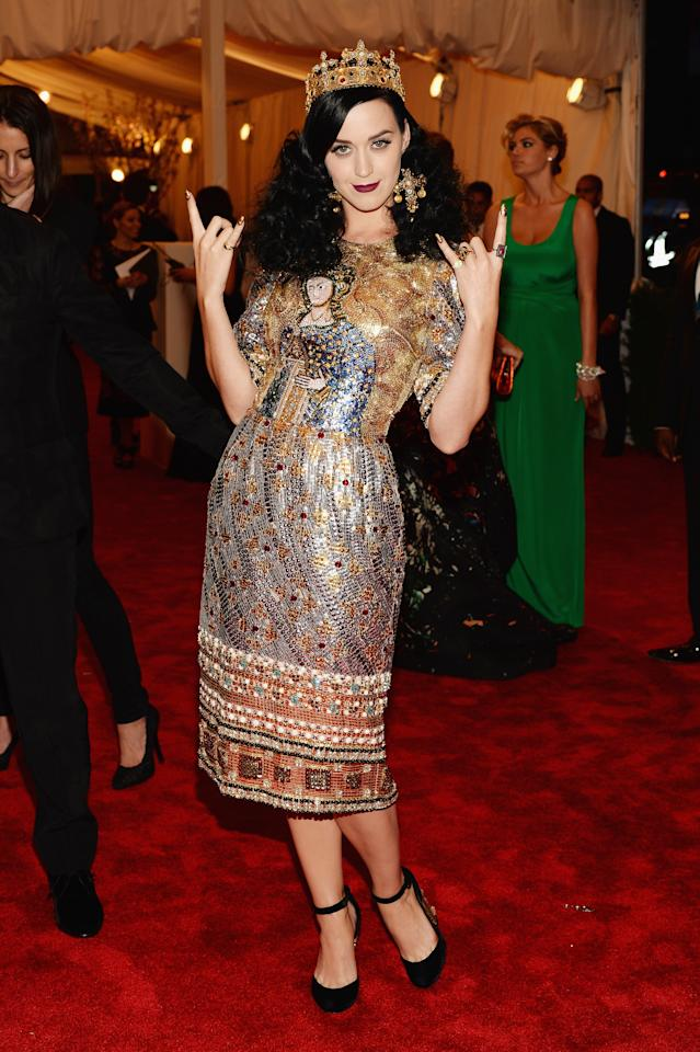 <p>Katy Perry has always been a leading fashionista and she made sure she stood out at the 2013 Met Gala in this punk-inspired get-up. Photo: Getty Images </p>