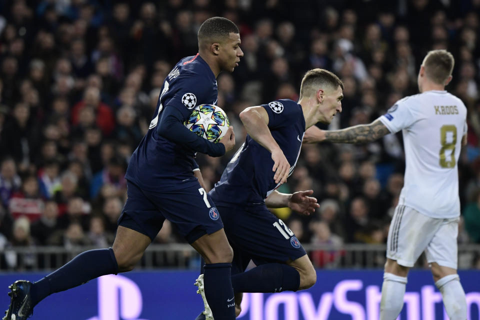 Paris Saint-Germain's French forward Kylian Mbappe (L) celebrates his goal with Paris Saint-Germain's Belgian defender Thomas Meunier during the UEFA Champions League group A football match against Paris Saint-Germain FC at the Santiago Bernabeu stadium in Madrid on November 26, 2019. (Photo by JAVIER SORIANO / AFP) (Photo by JAVIER SORIANO/AFP via Getty Images)