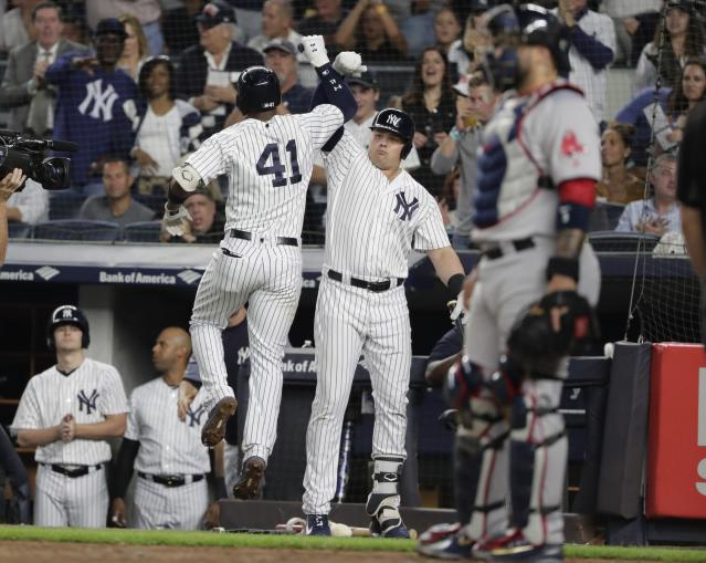 Boston Red Sox's Chris Sale (41) celebrates with Luke Voit after hitting a home run during the second inning of a baseball game, while Boston Red Sox catcher Sandy Leon stands at right Wednesday, Sept. 19, 2018, in New York. (AP Photo/Frank Franklin II)