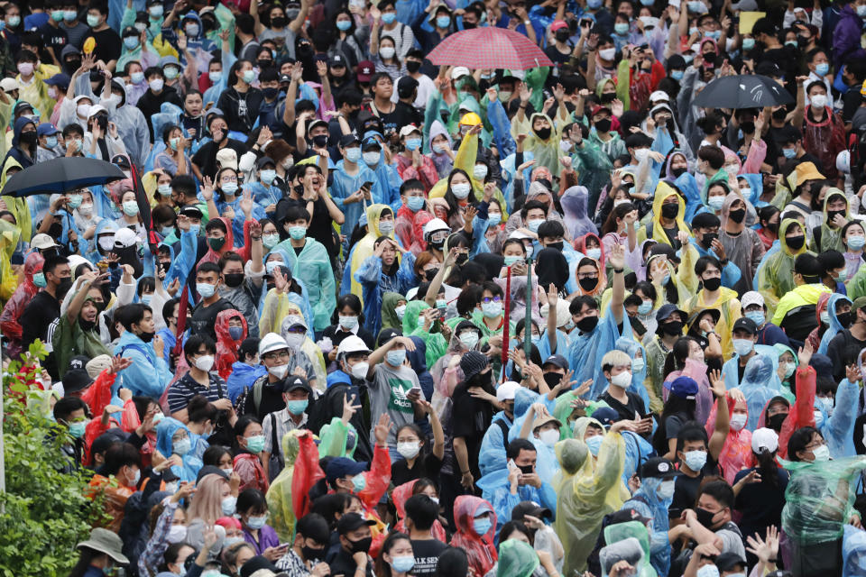 Pro-democracy protesters gather during a protest near a main train station in Bangkok, Thailand, Saturday, Oct. 17, 2020. The authorities in Bangkok shut down mass transit systems and set up roadblocks Saturday as Thailand's capital braced for a fourth straight day of determined anti-government protests. (AP Photo/Sakchai Lalit)