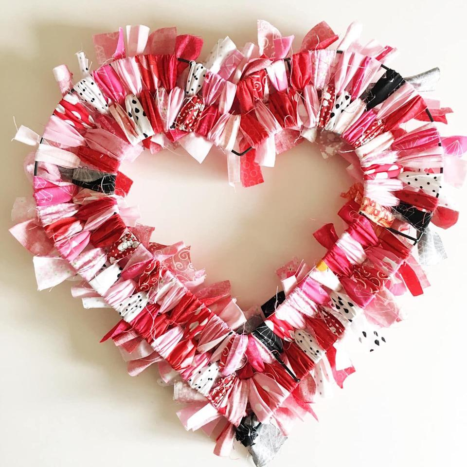 "<p>This beautiful heart-shaped wreath is deceptively simple to make: All you need are a pile of fabric scraps and a heart wire wreath form on which to tie your rag strips.</p><p><em><a href=""https://www.polkadotchair.com/heart-fabric-rag-wreath-tutorial/"" rel=""nofollow noopener"" target=""_blank"" data-ylk=""slk:Get the how-to at Polka Dot Chair»"" class=""link rapid-noclick-resp"">Get the how-to at Polka Dot Chair»</a></em><strong><br></strong></p><p><strong>RELATED: </strong><a href=""https://www.goodhousekeeping.com/holidays/valentines-day-ideas/g1132/diy-valentines-day-wreaths/"" rel=""nofollow noopener"" target=""_blank"" data-ylk=""slk:33 Darling Valentine's Day Wreaths to Welcome Guests All Winter"" class=""link rapid-noclick-resp"">33 Darling Valentine's Day Wreaths to Welcome Guests All Winter</a></p>"