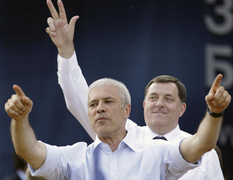 Pro-Western former Serbian President and presidential candidate Boris Tadic gestures in front of President of the Bosnian Serb region of Republic of Srpska Milorad Dodik, during a final pre-election rally in Belgrade, Serbia, Wednesday, May 2, 2012. Serbia's bid to join the European Union will be tested this weekend at a general election pitting ruling pro-European Union reformists against nationalists seeking closer ties with Russia. (AP Photo/Darko Vojinovic)