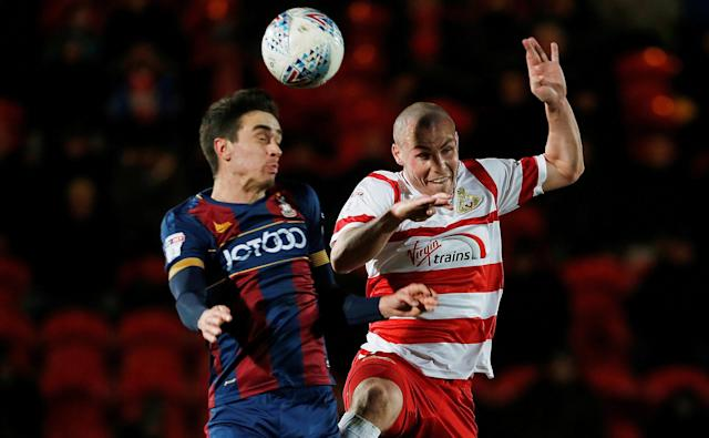 "Soccer Football - League One - Doncaster Rovers vs Bradford City - Keepmoat Stadium, Doncaster, Britain - March 19, 2018 Bradford City's Alex Gilliead (L) in action with Doncaster Rovers' Luke McCullough Action Images/Craig Brough EDITORIAL USE ONLY. No use with unauthorized audio, video, data, fixture lists, club/league logos or ""live"" services. Online in-match use limited to 75 images, no video emulation. No use in betting, games or single club/league/player publications. Please contact your account representative for further details."
