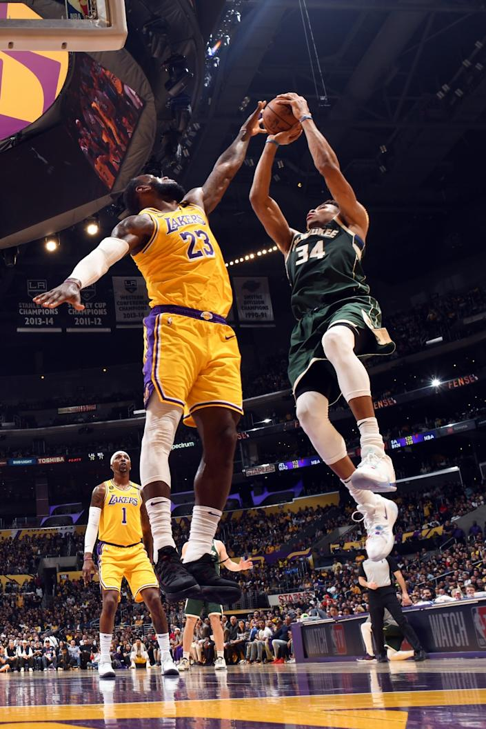 "Lakers' LeBron James attempts to block a shot by Milwaukee Bucks' Giannis Antetokounmpo on March 6 at Staples Center. <span class=""copyright"">(Andrew D. Bernstein / NBAE via Getty Images)</span>"