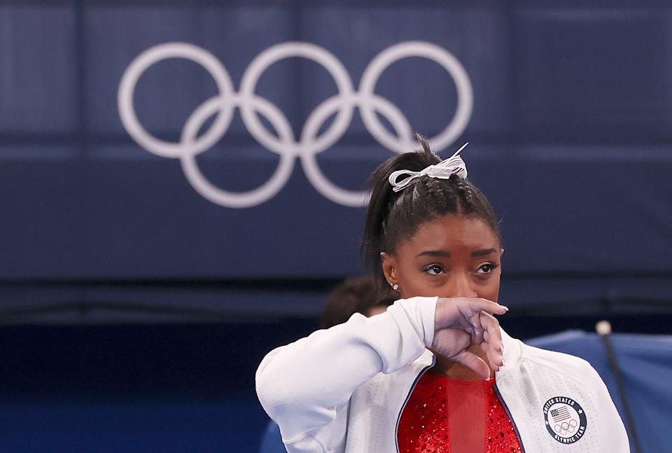 Simone Biles of the United States watches her teammates after withdrawing from the artistic gymnastics women's team final at the Tokyo 2020 Olympic Games in Tokyo, Japan, July 27, 2021. (Photo by Cao Can/Xinhua via Getty Images)