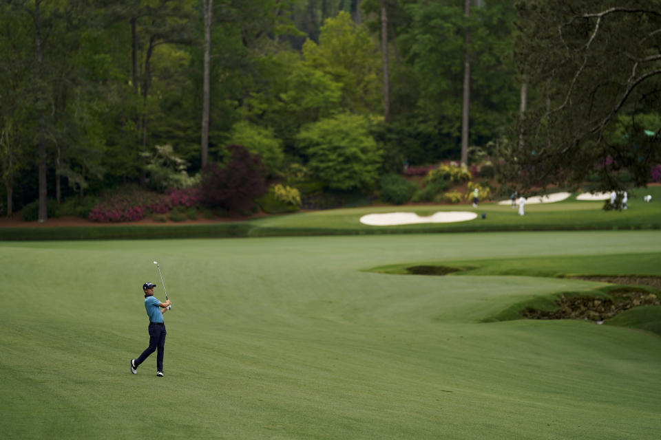 Justin Thomas hits from the fairway on the 13th hole during the second round of the Masters golf tournament on Friday, April 9, 2021, in Augusta, Ga. (AP Photo/David J. Phillip)