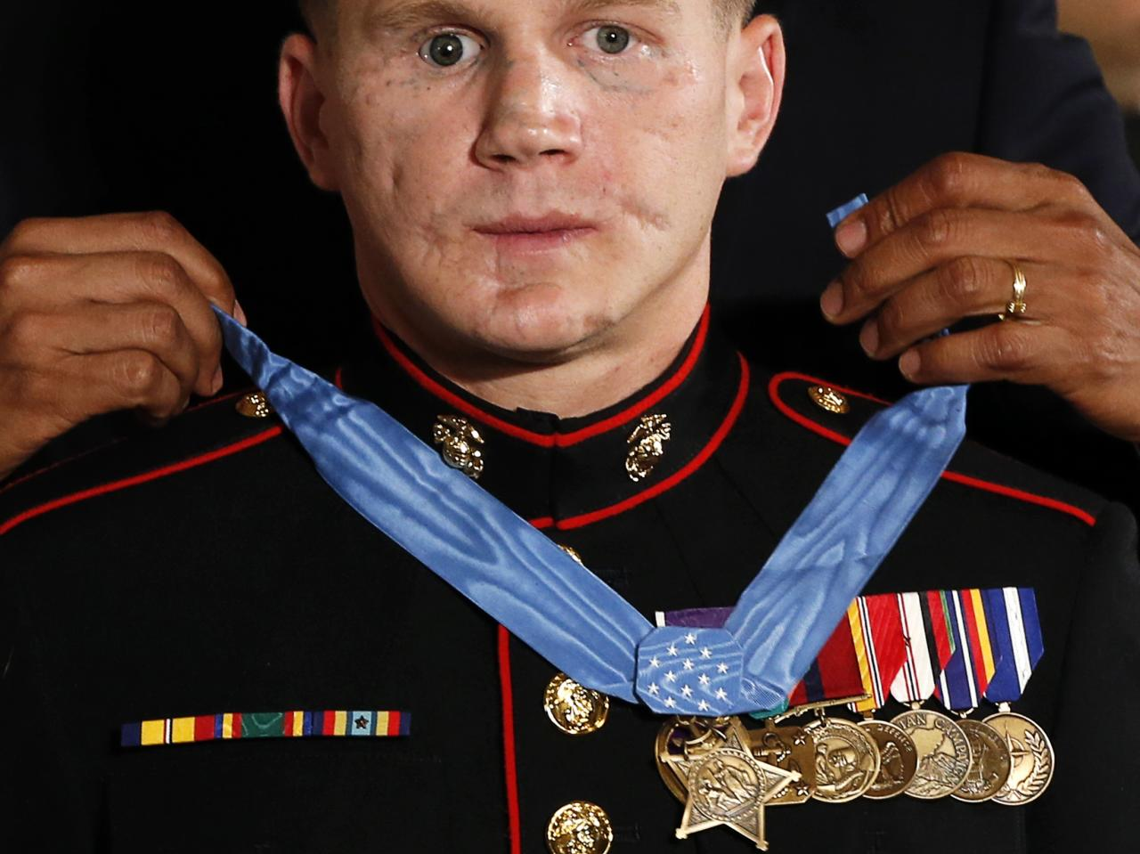 "U.S. President Barack Obama presents the Medal of Honor to retired U.S. Marine Corps Corporal William ""Kyle"" Carpenter during a ceremony at the White House in Washington June 19, 2014. Carpenter received the award for ""conspicuous gallantry"" performed while serving in Helmand Province, Afghanistan. 