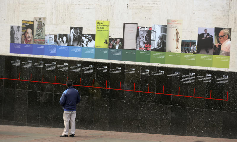 A man looks at a timeline of the life of the late Colombian author Gabriel Garcia Marquez on a wall at the Luis Angel Arango Library in downtown Bogota, Colombia, Thursday, April 17, 2014. The Nobel laureate died in Mexico City on Thursday. Garcia Marquez was among Latin America's most popular writers and widely considered the father of a literary style known as magic realism. (AP Photo/Ricardo Mazalan)