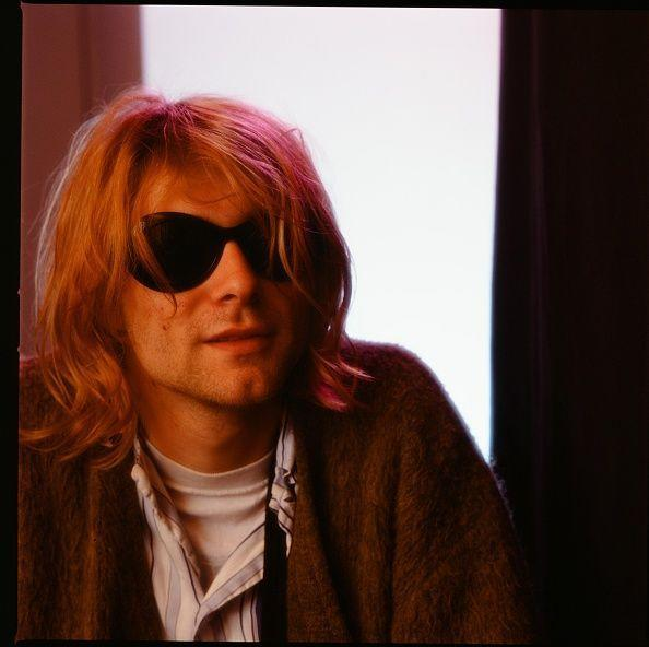 <p>Kurt Cobain at a hotel in Tokyo in November 1991. Before Nirvana, Cobain formed a band right after he dropped out of high school called Fecal Matter.</p>