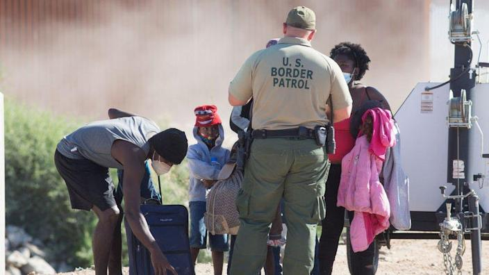 A family from Honduras turns themselves into the Border Patrol after crossing the United States border from Mexico on April 29, 2021 near Yuma, Arizona