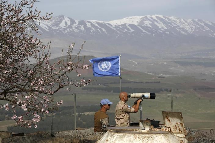 UN members monitor the Israel-Syria border after on Saturday, February 10, 2018, the day the Syrian government said it fended off an Israeli raid on a military base in the centre of the country (AFP Photo/JALAA MAREY)