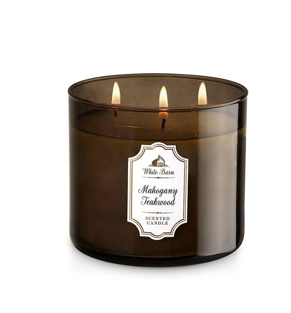 """<p><strong>Bath & Body Works</strong></p><p>amazon.com</p><p><strong>$19.97</strong></p><p><a href=""""https://www.amazon.com/dp/B0094B2G9E?tag=syn-yahoo-20&ascsubtag=%5Bartid%7C10072.g.23584712%5Bsrc%7Cyahoo-us"""" rel=""""nofollow noopener"""" target=""""_blank"""" data-ylk=""""slk:SHOP NOW"""" class=""""link rapid-noclick-resp"""">SHOP NOW</a></p><p>Not only do Bath & Body Works' popular three-wick candles burn up to 45 hours, but they also permeate an entire room. Mahogany Teakwood combines woodsy aromas with a hint of lavender and geranium. </p>"""