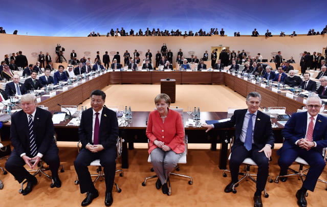 <p>From left: US President Donald Trump, China's President Xi Jinping, German Chancellor Angela Merkel, Argentina's President Mauricio Macri and Australia's Prime Minister Malcolm Turnbull turn around for photographers at the start of the first working session of the G20 meeting in Hamburg, northern Germany, on Friday, July 7, 2017. (John MacDougall/Pool Photo via AP) </p>