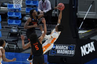 Oregon State forward Warith Alatishe (10) blocks a Tennessee guard Keon Johnson (45) shot during the first half of a first round game at Bankers Life Fieldhouse in the NCAA men's college basketball tournament in Indianapolis,Friday, March 19, 2021. (AP Photo/Paul Sancya)