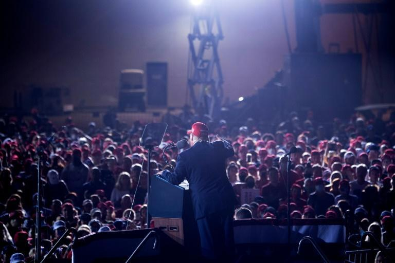 US President Donald Trump speaks at a rally in Florida early on Monday