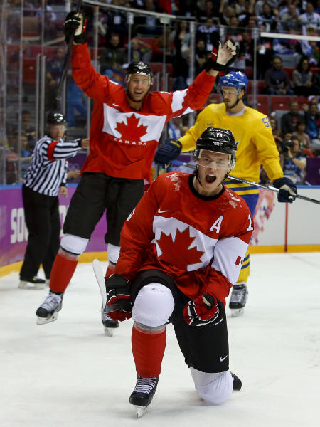 Canada forward Jonathan Toews reacts after scoring a goal against Sweden during the first period of the men's gold medal ice hockey game at the 2014 Winter Olympics, Sunday, Feb. 23, 2014, in Sochi, Russia. (AP Photo/Matt Slocum)