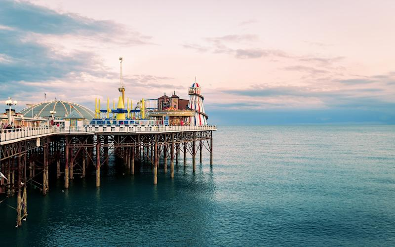 The quintessential Brighton Pier is still a key landmark on the city's seafront - Kenji Lau