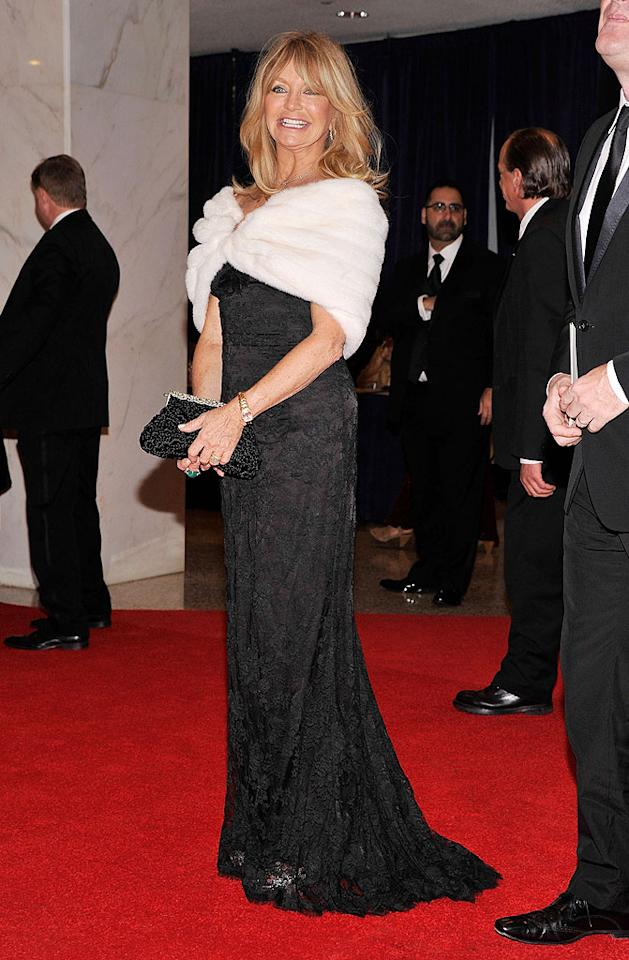 "<p class=""MsoNormal"">As the invited guest of CNN's Piers Morgan, Goldie Hawn spiced things up in her black slip-style gown with a lace overlay and white fur stole.</p>"