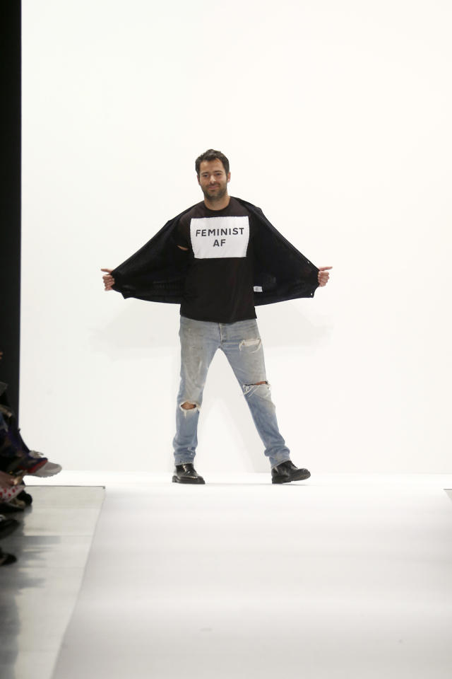 "<p>Jonathan Simkhai walks the runway during the finale of his collection's spring-summer 2018 show wearing a shirt that read, ""Feminist AF."" (Photo: Getty Images) </p>"