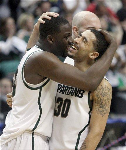 Michigan State forward Draymond Green, left, and guard Brandon Wood (30) celebrate after an NCAA college basketball game against Ohio State in the final of the Big Ten Conference men's tournament in Indianapolis, Sunday, March 11, 2012. Michigan State won 68-64. (AP Photo/Kiichiro Sato)