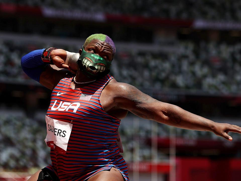 Raven Saunders wears a Hulk mask while shotputting at the Tokyo Olympics.
