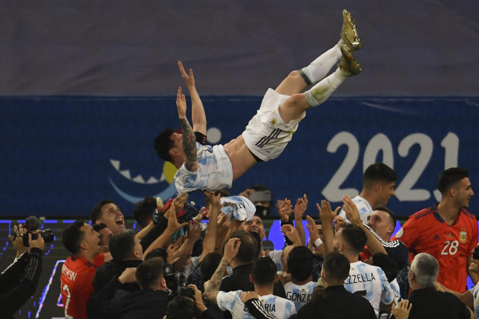 Argentina's Lionel Messi is thrown into the air by teammates after winning the Conmebol 2021 Copa America football tournament final match against Brazil at Maracana Stadium in Rio de Janeiro, Brazil, on July 10, 2021. (Photo by MAURO PIMENTEL / AFP) (Photo by MAURO PIMENTEL/AFP via Getty Images)
