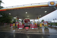A fuel delivery is made to a petrol station which had run out of fuel after an outbreak of panic buying in the UK, in Manchester, England Monday, Sept. 27, 2021. British Prime Minister Boris Johnson is said to be considering whether to call in the army to deliver fuel to petrol stations as pumps ran dry after days of panic buying. ( AP Photo/Jon Super)