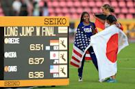 <p>Tara Davis of The USA, Lea-Jasmin Riecke of Germany and Ayaka Kora of Japan celebrate after winning medals in the final of the women's long jump on day four of The IAAF World U20 Championships on July 13, 2018 in Tampere, Finland. (Photo by Stephen Pond/Getty Images for IAAF)</p>