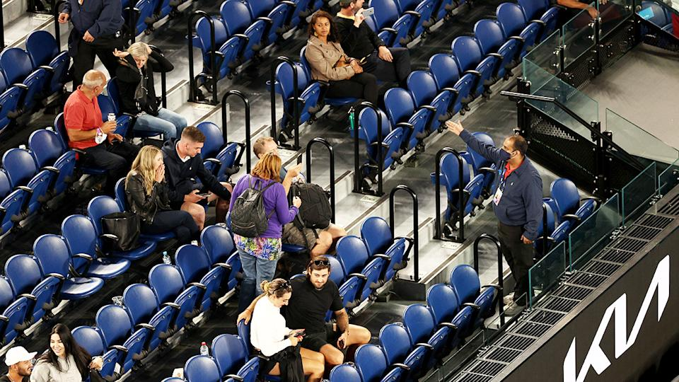 Australian Open staff and security, pictured here asking fans to leave.