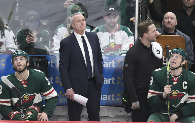 Minnesota Wild's interim head coach Dean Evason looks up at the clock in the third period of an NHL hockey game against the San Jose Sharks, Saturday, Feb. 15, 2020, in St. Paul, Minn. Evason replace Bruce Boudreau who was fired.San Jose won 2-0.(AP Photo/Tom Olmscheid)
