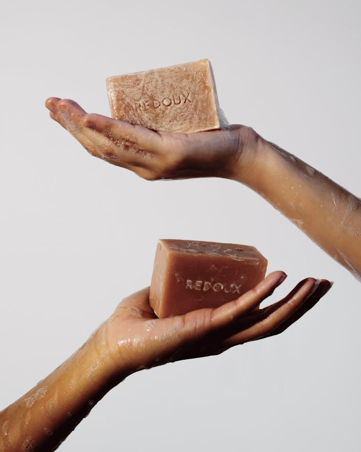 """Redoux founder Asia Grant created a line of scents and vegan skin care that has sustainability at its core, with packaging that is 100% recyclable and ingredients that are ethically sourced. The small-batch, handmade bar soap, in particular, uses minimal packaging, and the turmeric soap is a fan favorite because of its skin-brightening, natural ingredients in combo with a spicy citrus scent. $16, Redoux. <a href=""""https://redoux.nyc/products/turmeric-botanical-bar"""" rel=""""nofollow noopener"""" target=""""_blank"""" data-ylk=""""slk:Get it now!"""" class=""""link rapid-noclick-resp"""">Get it now!</a>"""
