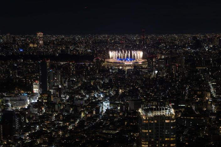 <p>Fireworks are displayed over the Olympic Stadium during the closing ceremony of the Tokyo Olympics.</p>