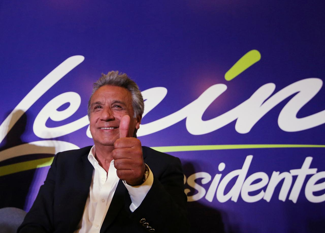 Lenin Moreno, candidate of the ruling PAIS Alliance Party, gestures at the Hotel Colon during the presidential election in Quito, Ecuador February 19, 2017. REUTERS/Mariana Bazo