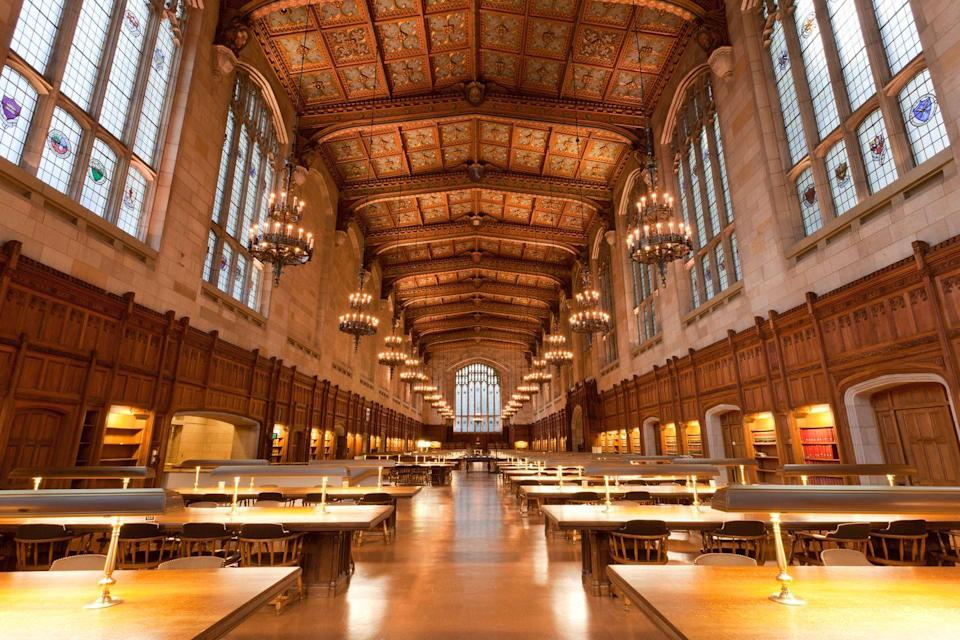 """<p>Hogwarts, is that you? The University of Michigan <a href=""""https://www.law.umich.edu/library/home/Pages/default.aspx"""" rel=""""nofollow noopener"""" target=""""_blank"""" data-ylk=""""slk:Law Library"""" class=""""link rapid-noclick-resp"""">Law Library</a> looks remarkably like the school of magic's great hall with its 50-foot vaulted cathedral ceiling and chandeliers. </p>"""