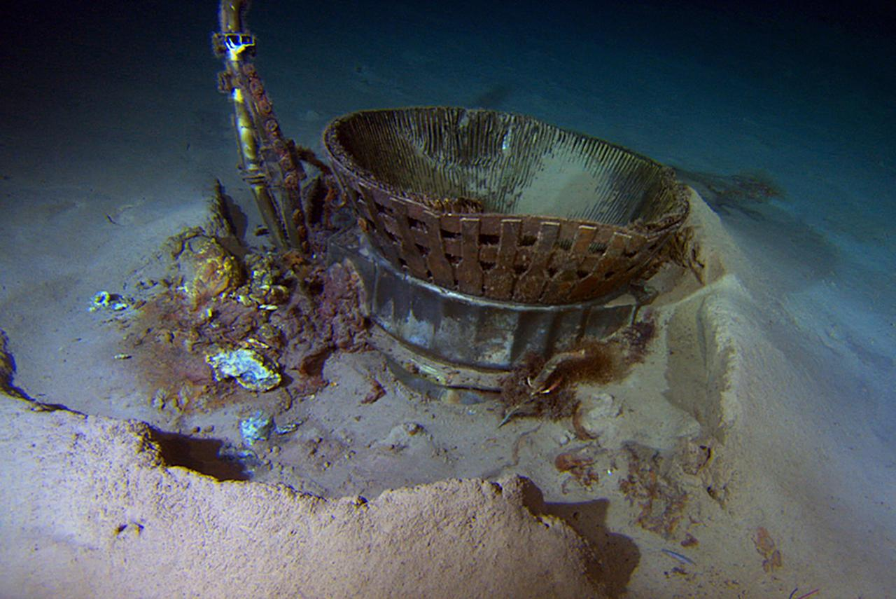 A thrust chamber from an Apollo F-1 engine pictured at the bottom of the Atlantic Ocean. Major components of the rocket engines used to launch astronauts to the Moon in the 1960s and 1970s were recovered this week. The F-1 engines used to power the Saturn V rockets that blasted Apollo capsules to the moon were found three miles below sea level. It is not yet known which Apollo mission they belong to but there is a possibility it could belong to Apollo 11, which was the first mission to successfully land men on Moon (Reuters)<br /><br />