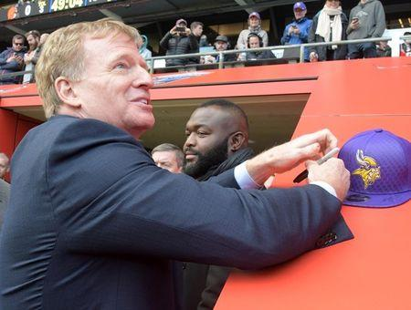 Oct 29, 2017; London, United Kingdom; NFL commissioner Roger Goodell signs autographs during an NFL International Series game between the Minnesota Vikings and the Cleveland Browns at Twickenham Stadium. Kirby Lee-USA TODAY Sports
