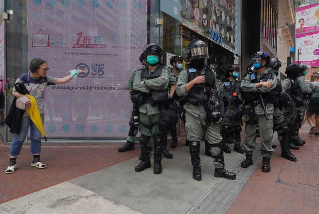 Riot police standing guard in Hong Kong (VIncent Yu/AP)