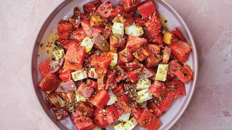 "Red, juicy, and sweet, tomatoes and watermelon are soul mates, and they both need salt, spice, and fat to reach their full potential. Make sure your tomatoes and watermelon are room temperature: If they're too cold, they'll make the spiced coconut oil seize. <a href=""https://www.bonappetit.com/recipe/tomato-watermelon-salad-with-turmeric-oil?mbid=synd_yahoo_rss"" rel=""nofollow noopener"" target=""_blank"" data-ylk=""slk:See recipe."" class=""link rapid-noclick-resp"">See recipe.</a>"