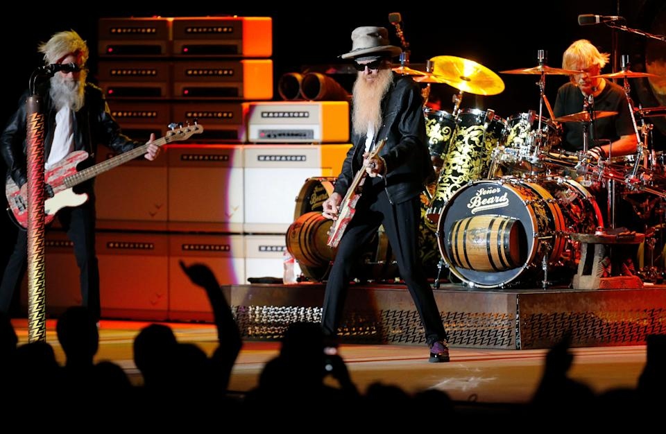 ZZ Top plays the Tuscaloosa Amphitheater Thursday, July 30, 2021, in Tuscaloosa, Ala., following the death of bass player Dusty Hill. Elwood Francis, left, replaced Hill on bass guitar, joining Frank Beard on drums and Billy Gibbons on lead guitar and vocals. [Staff Photo/Gary Cosby Jr.]