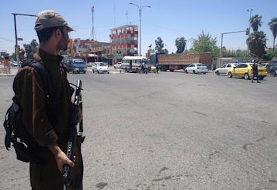 A fighter with the al-Qaida-inspired Islamic State of Iraq and the Levant (ISIL) takes control of a traffic intersection in the northern city of Mosul, 225 miles (360 kilometers) northwest of Baghdad, Iraq, Sunday, June 22, 2014. (AP Photo)