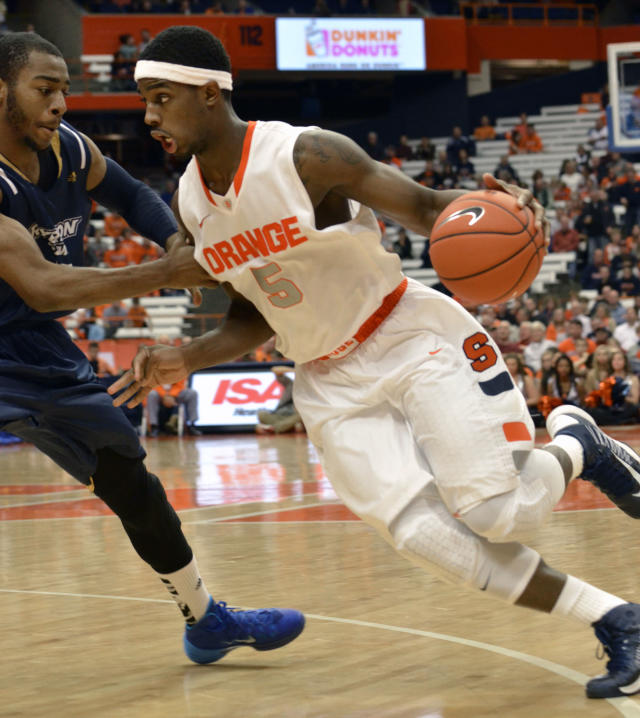 Syracuse's C. J. Fair drives against Ryerson's Aaron Best during the second half of a men's NCAA exhibition basketball game in Syracuse, N.Y., Tuesday, Nov. 5, 2013. Syracuse won 81-46. (AP Photo/Kevin Rivoli)