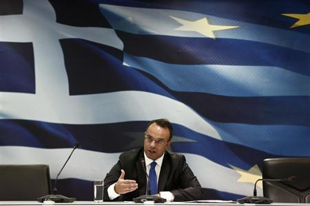 Greek Deputy Finance Minister Christos Staikouras addresses reporters during a briefing at a ministry hall in Athens
