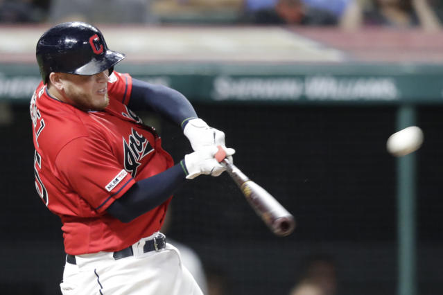 FILE - In this Sept. 3, 2019, file photo, Cleveland Indians' Roberto Perez hits a three-run home run in the seventh inning in a baseball game against the Chicago White Sox, in Cleveland. Indians catcher Roberto Perez had surgery to remove bone spurs in his right ankle. The team said Prez underwent the arthroscopic procedure Thursday, Oct. 17, 2019, in Green Bay, Wisconsin. (AP Photo/Tony Dejak, File)