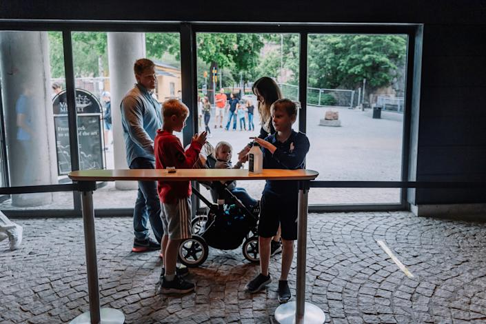 Visitors use sanitizer before entering the Vasa Museum in Stockholm on July 15, 2020 on the day of its reopening amid the new coronavirus pandemic. / Credit: STINA STJERNKVIST/TT News Agency/AFP/Getty