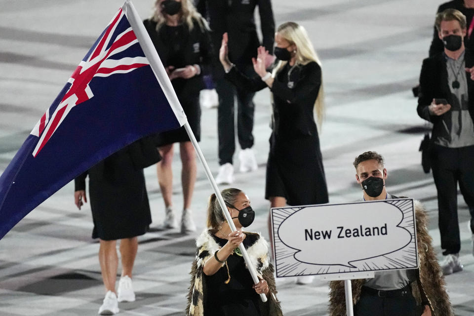 Sarah Hirini and David Nyika, of New Zealand, carry their country's flag during the opening ceremony in the Olympic Stadium at the 2020 Summer Olympics, Friday, July 23, 2021, in Tokyo, Japan. (AP Photo/David J. Phillip)