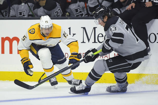 Los Angeles Kings center Tyler Toffoli, right, moves the puck as Nashville Predators center Craig Smith puts pressure on him during the second period of an NHL hockey game Saturday, Oct. 12, 2019, in Los Angeles. (AP Photo/Mark J. Terrill)